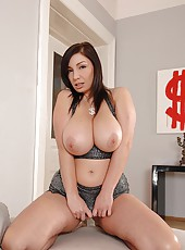 A brunette with large boobs toying