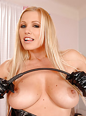 Latex blonde teasing her round tits