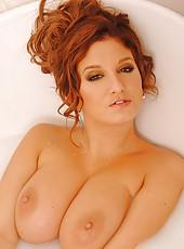 Jenny McClain poses wild in bath
