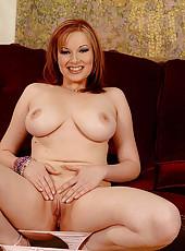 Busty redhead Ricky strips naked