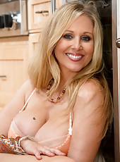 Busty blonde MILF Julia Ann has hot sex in the kitchen with big cocked friend.