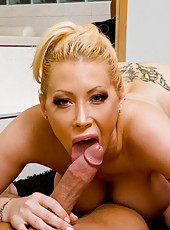 Horny housewife Candy Manson fucks and sucks her husbands hot cock.