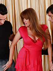 Hot mom Darla Crane is horny and ready to suck and fuck two big cocks at the same time in this threesome.
