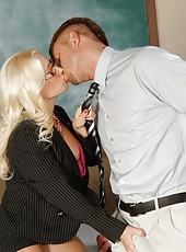 Hot blonde busty teacher is horny and decides to fuck one of her big cocked students.