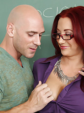 Busty teacher Jayden Jaymes has sex on her desk and fucks her student.