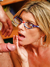 Blonde teacher decides to fuck and suck a student off in the library.