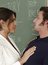 Busty brunette teacher has hot sex with one of her students in her classroom.