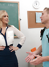 Busty blonde teacher seduces her student so he does not fail and makes him fuck her.