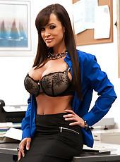 Busty brunette teacher Lisa Ann gets fucked on desk by student.