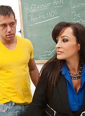 Busty brunette teacher Lisa Ann gets fucked on desk by student.