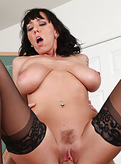 Hot brunette teacher Alia Janine swallows cock on her desk and gets her tight pussy pumped.