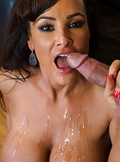 Busty hot Lisa Ann seduces younger guy and rides his cock on the couch.