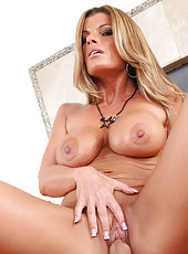 Hot blonde cougar Kristal Summers loves to suck and ride younger cock.