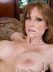 Busty redhead MILF fucks her son