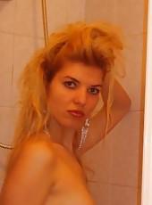 Blonde wife posing in lingerie