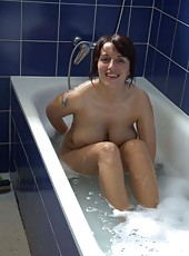 Busty MILF naked in the bath