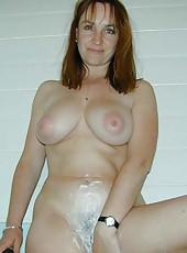 Big-tittied MILF posing naked