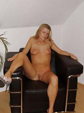 Naked wife posing around