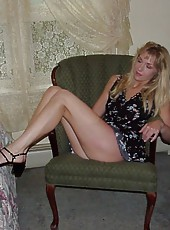 Blonde MILF does a striptease
