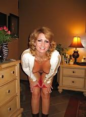 Hot and pretty redhead MILF posing