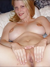 Sexy blonde MILF stripping