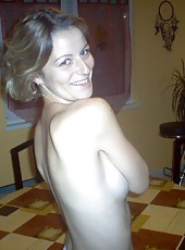 Naked housewife posing and showing her stuff
