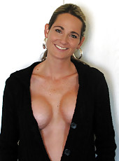 Sexy MILF topless and showing off tits