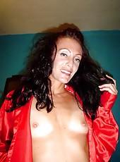 Horny brunette MILF naked and posing