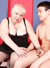 Big old mommy just can't stop gagging on a horny boy's dick