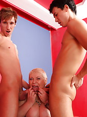 Two guys let chubby oldie suck them off and fuck her asshole