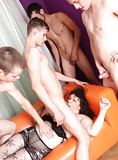 Four guys share an old bitch addicted to all-hole fucking