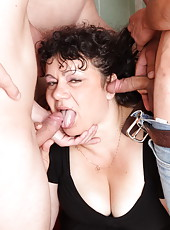 Oldie�s hairy pussy takes a pounding from a crowd of guys