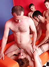 Boys crowded around a ginger-haired plumper pleasing them
