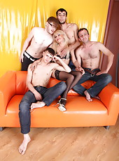 Hot blond MILF in a middle of an all-hole Old+Young gangbang