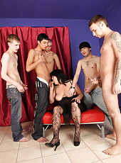 A gang of youngsters allowing hot mommy to taste their dicks