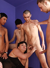 This mommy never minds sucking several guys off at once
