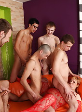 Five young dudes putting it on old redhead's mouth and pussy