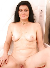 Pretty long haired old woman plays in the shower