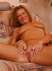 Playful old woman undresses and rubs her pussy