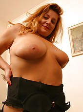 Voluptious old woman shows her boobs & tight pussy