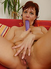 Naighty old woman stretches pussy with huge dildo