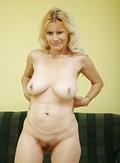 Cute old woman shows off and enjoys a young cock