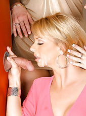 3 hot milfs suck on a cock through the glory hole then get their pussies fucked and finger banged in these hot group fucking pics