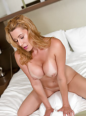 Busty blonde milf fingers her cum hungry pussy