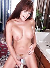 Naughty Anilos Joann Adams fucks her pussy in the kitchen