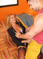 Rio plays with a dildo while a male stripper dances for her