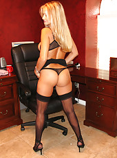 Hot secretary at work stripping down to her stockings and lifting up her skirt