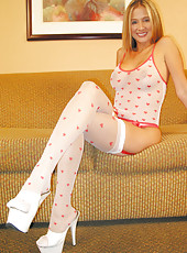 Rio posing in a sheer top with woven hearts and matching stockings and panties