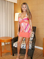 Rio puts on a micro mini skirt with no panties and strips for a lucky guy