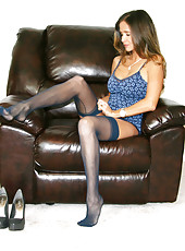 HotWifeRio poses in a pair of blue stockings then gets a load of cum shot on her